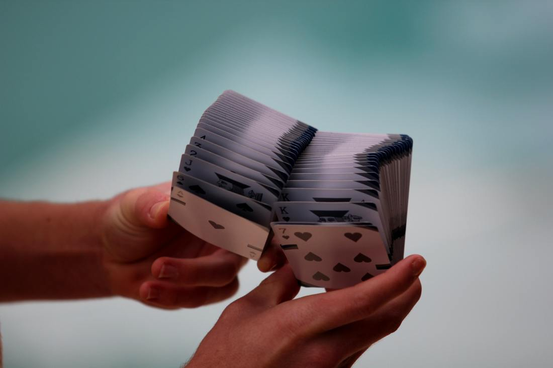 Photo of a cardist makes a fan out of playing cards.